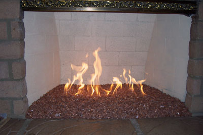 The Fireplace Below Is A Propane Fireplace. A Bed Of Crushed Lava Was  Installed And A Clear Base Glass Was Used To Cover It All Up.
